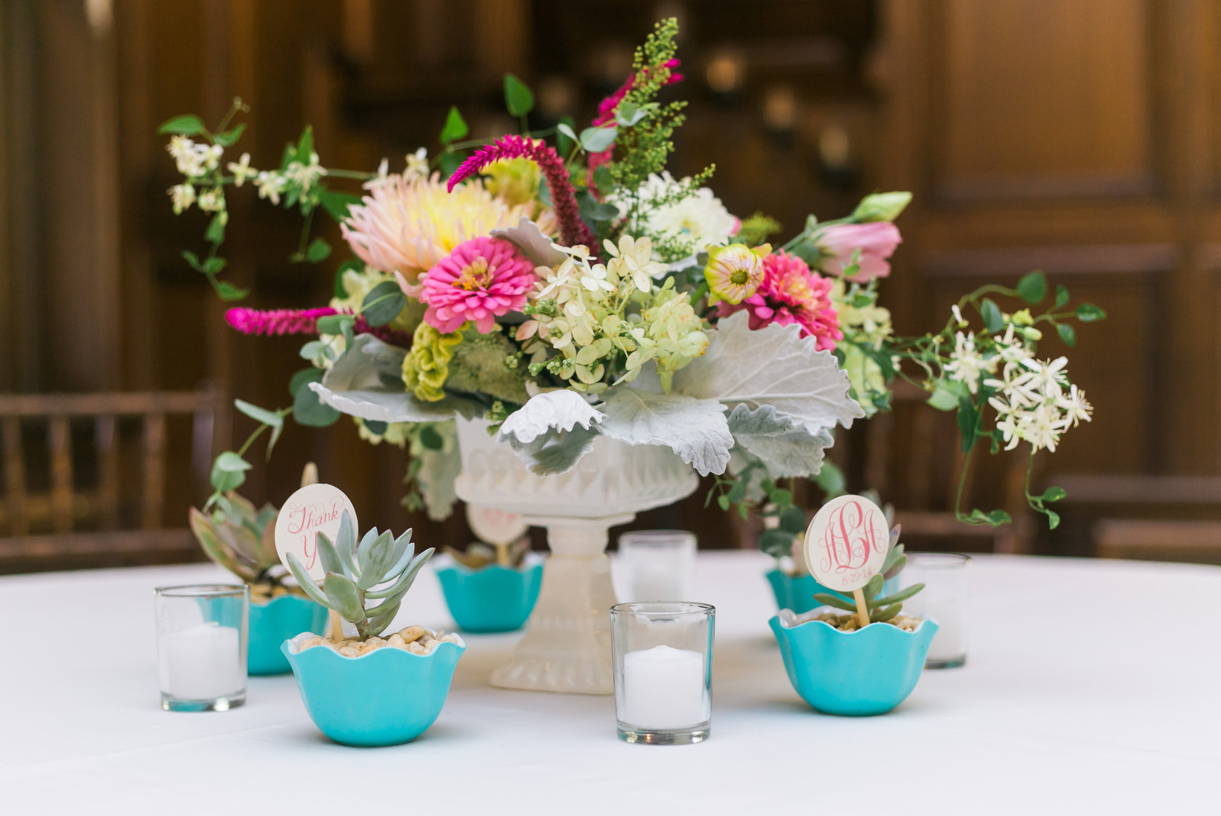 mid summer centerpiece in a vintage candy dish with table numbers