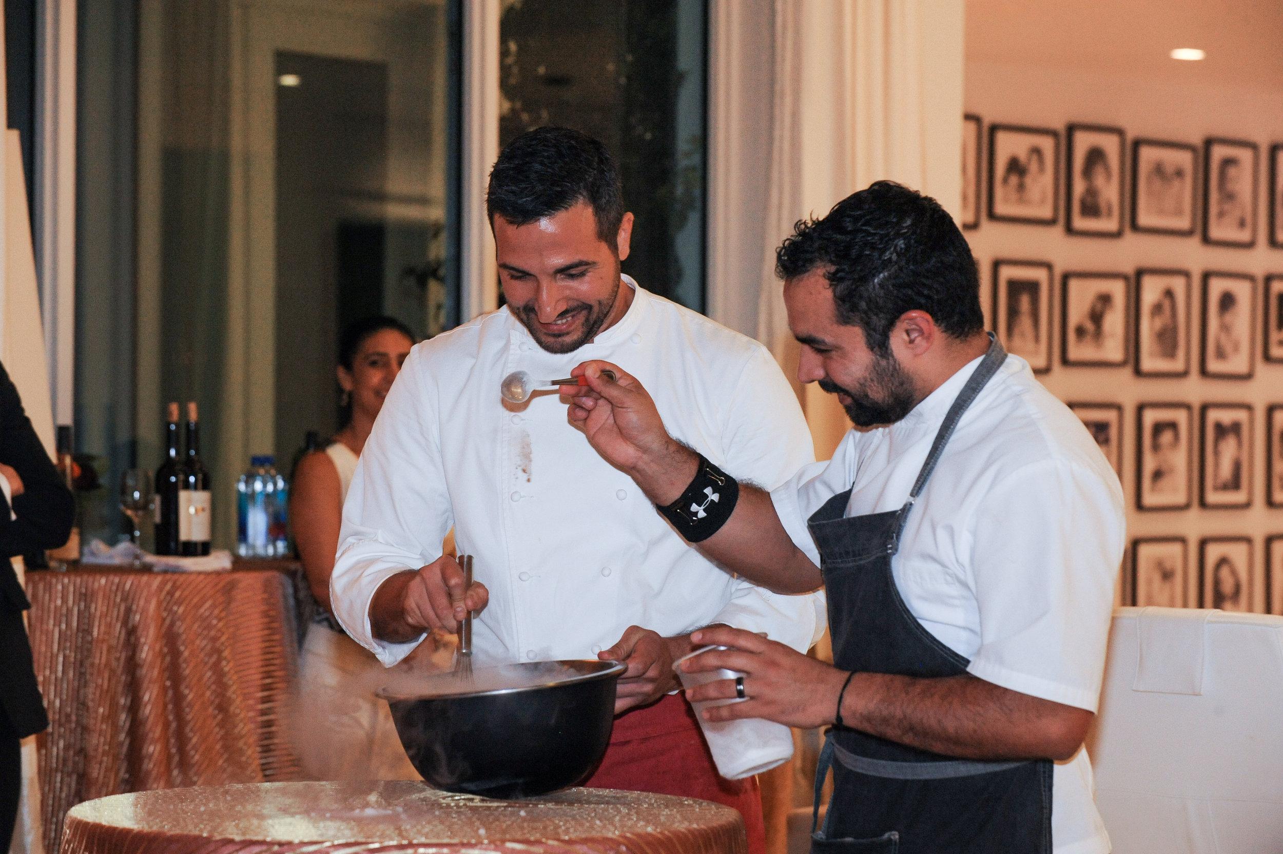 Chef Minas and Chef Christopher Nunez demonstrating orange sorbet made with liquid nitrogen
