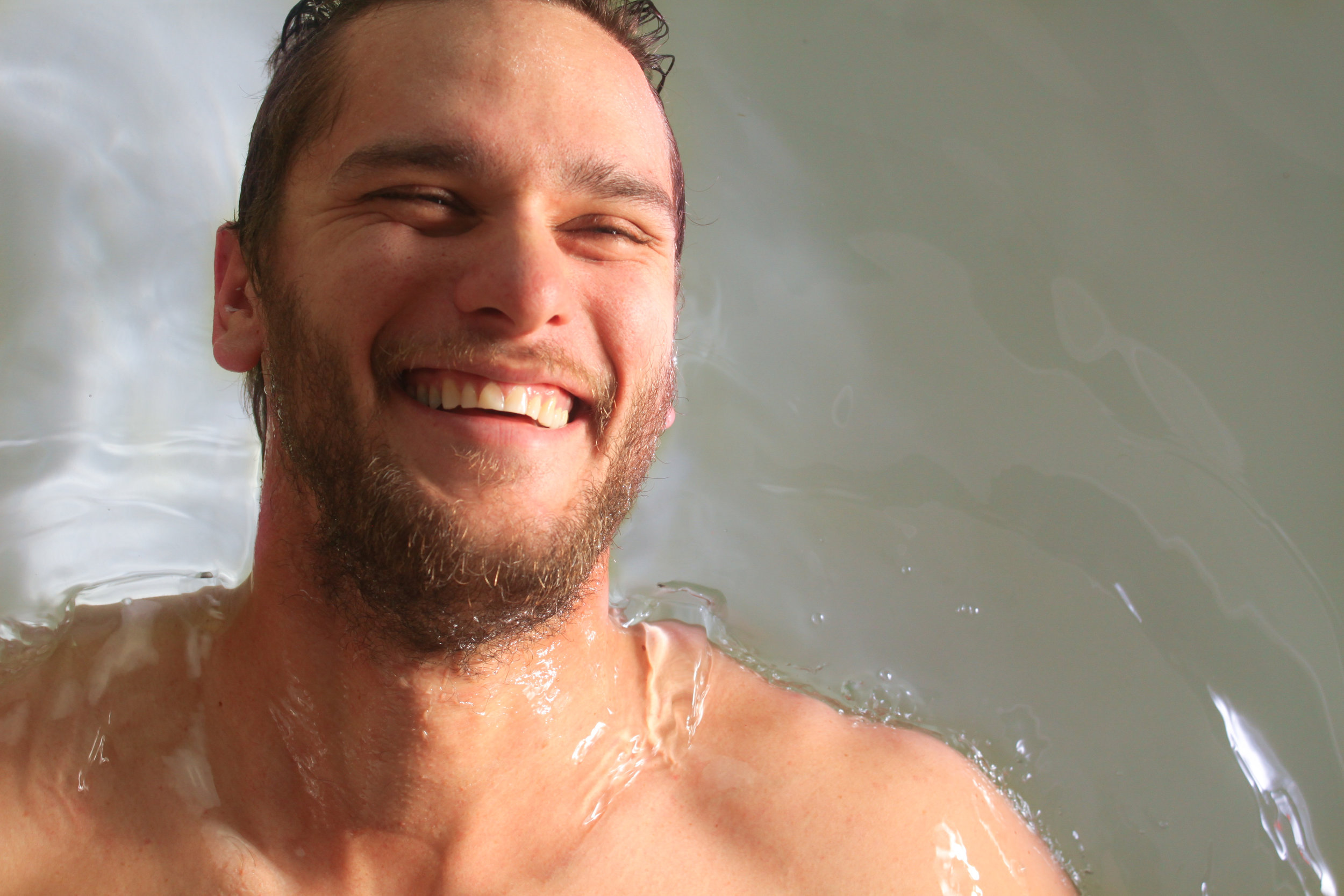 Guy Smiling While Floating in Water