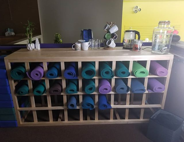 The new yoga mat cabinet is finished! I just put the last part together yesterday morning and loaded it up with mats.  The prop area is coming together nicely.  #yoga #asana #pranayama #meditation #selfcare #jrryoga #yogamats #woodworking #homemade #yogamatcabinet