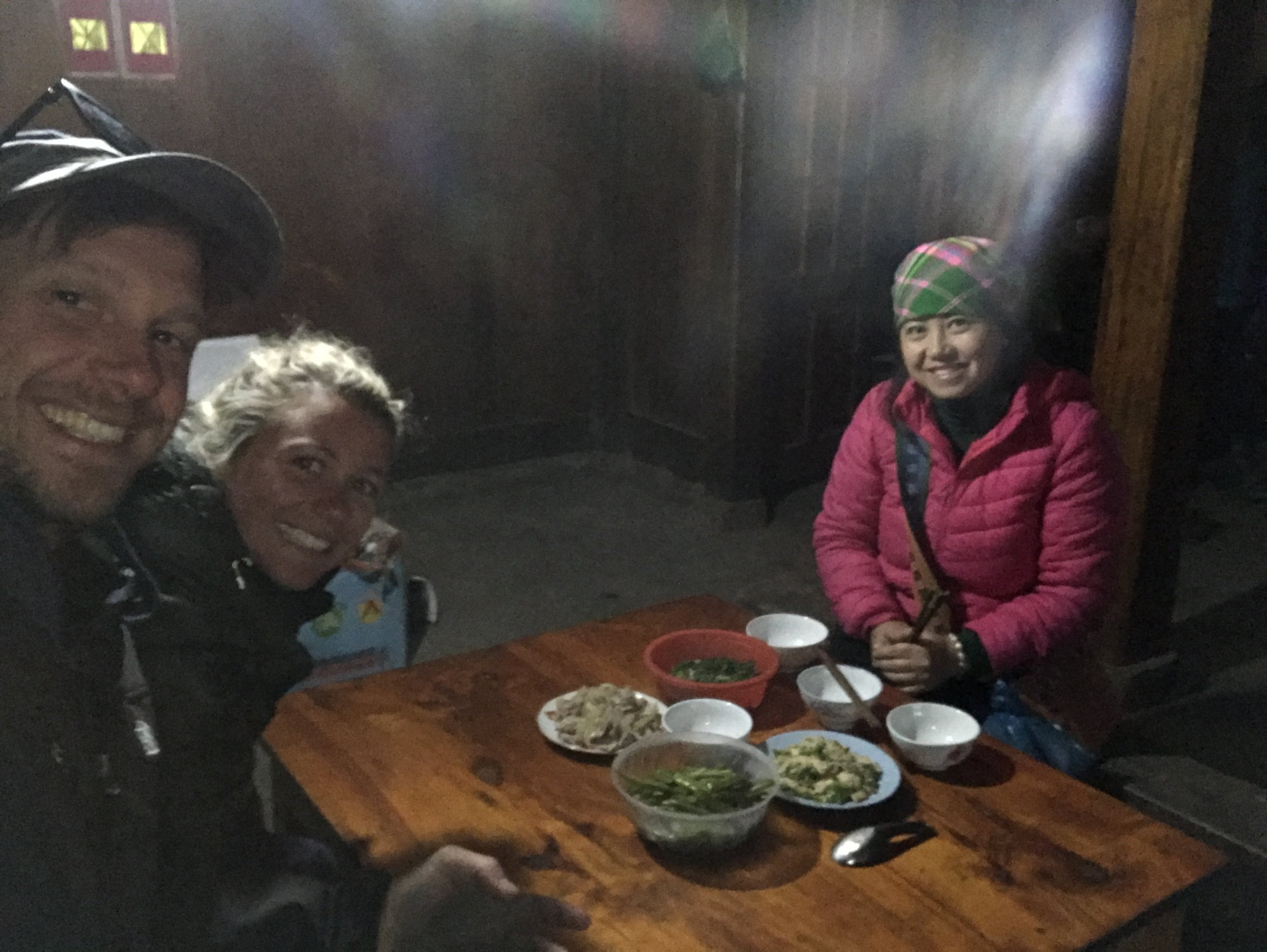 Giang (Zao) and Katie & Tom sharing lunch prepared by a local family in their home