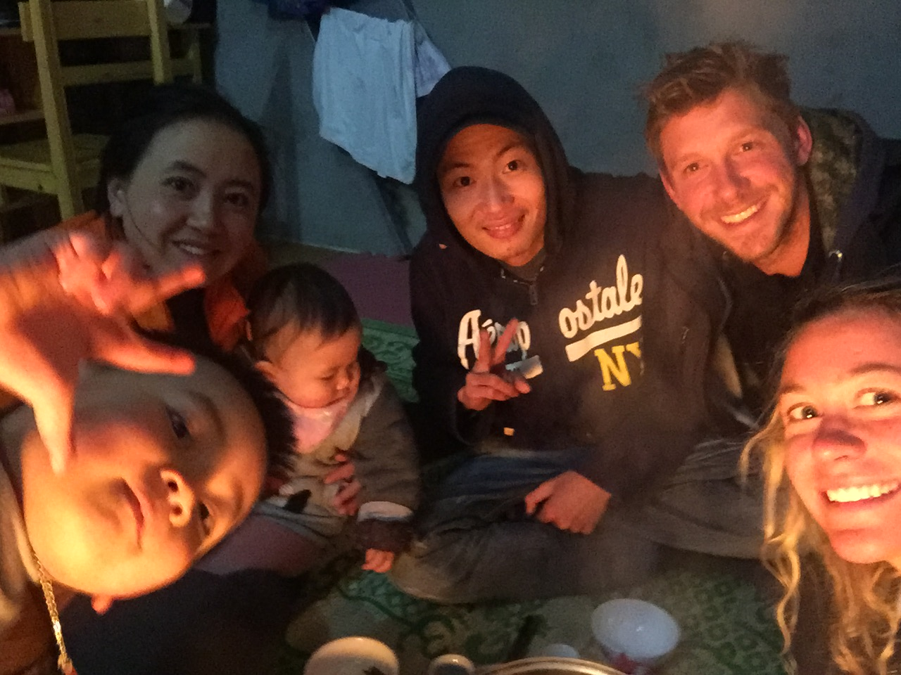 Giang (Zao) and Katie with their families enjoying a delicious meal at Zao's home