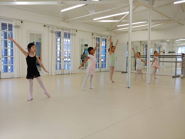 Dancers in the Elementary Intensive practice their choreography for Friday.