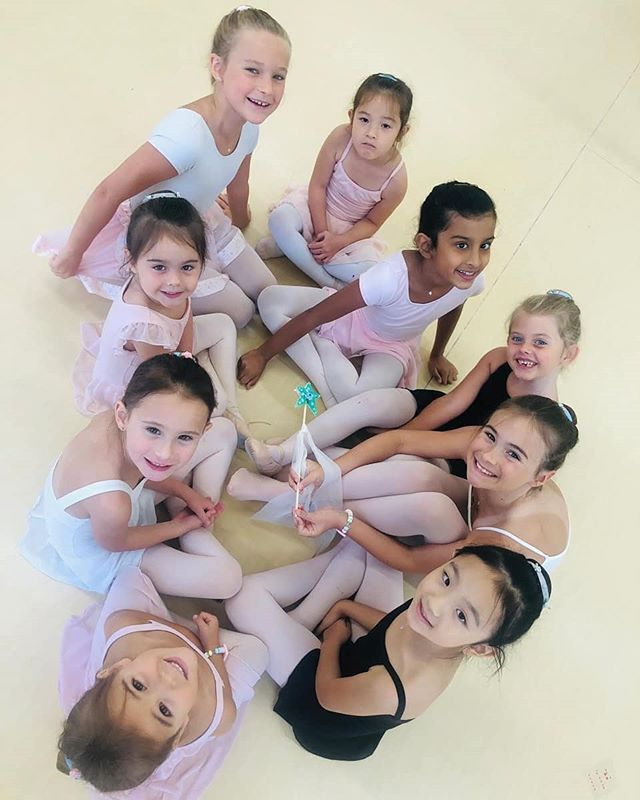 Learning to do a proper ballet bun with the ribbons they decorated beautifully yesterday.