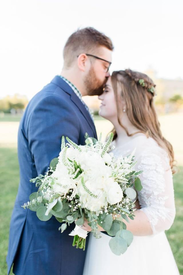 BridesbyYoung-RealBride-PlusSizeCurvyWeddingDress-JessicaRobert-5.jpg