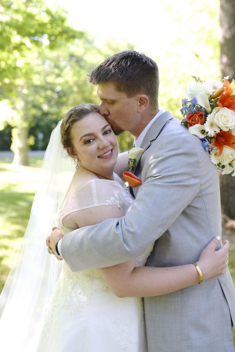BridesbyYoung-RealBride-PlusSizeCurvyWeddingDress-MariyaChris-20.jpg