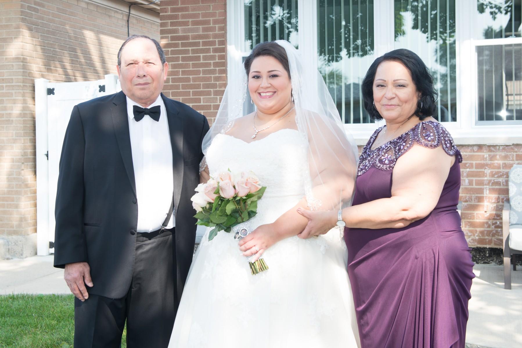 BridesbyYoung-RealBride-PlusSizeCurvyWeddingDress-MargieMichael-15.jpg