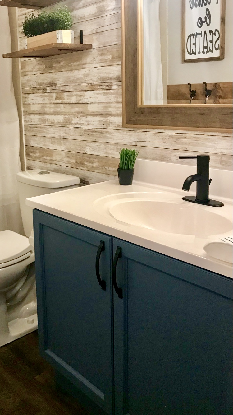 This was a powder room in our previous home, the vanity was painted with  BEHR® Alkyd  Blue Print   I
