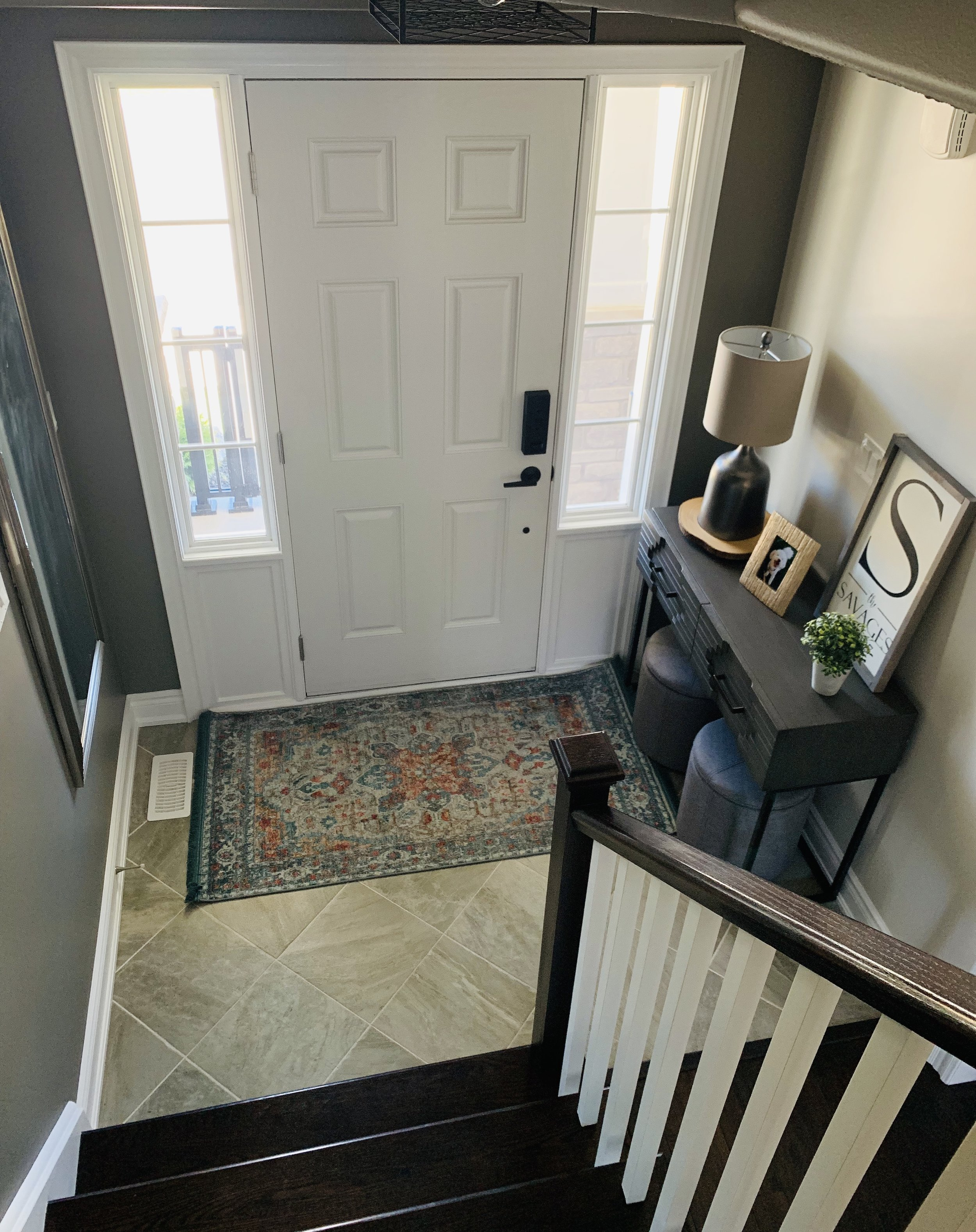 """You can see in this photo where we transitioned from """"Off White"""" to """"Wet Cement"""" and carried it up the stairs and into the loft"""