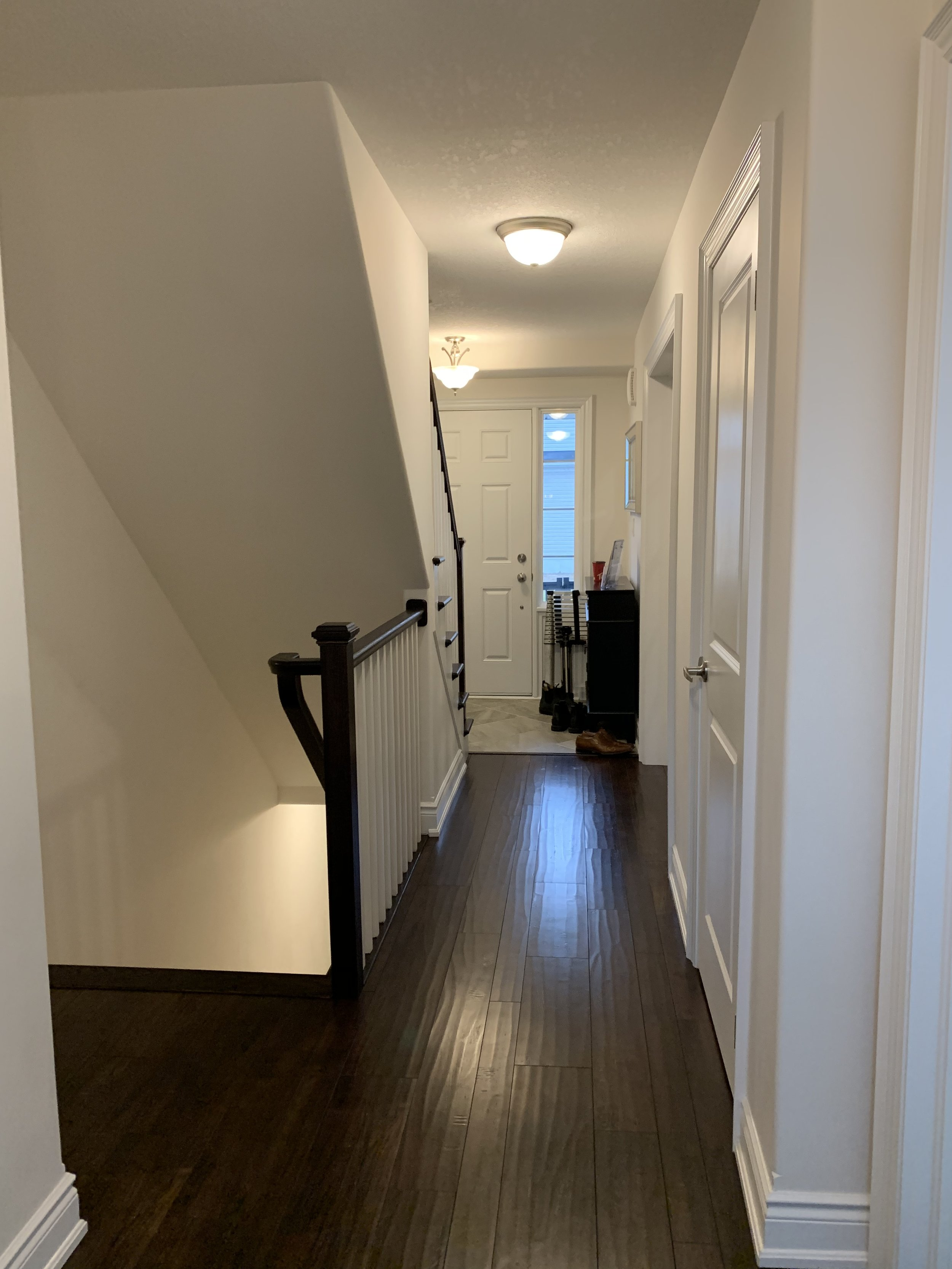 Hallway leading from kitchen to entryway/front door - Before