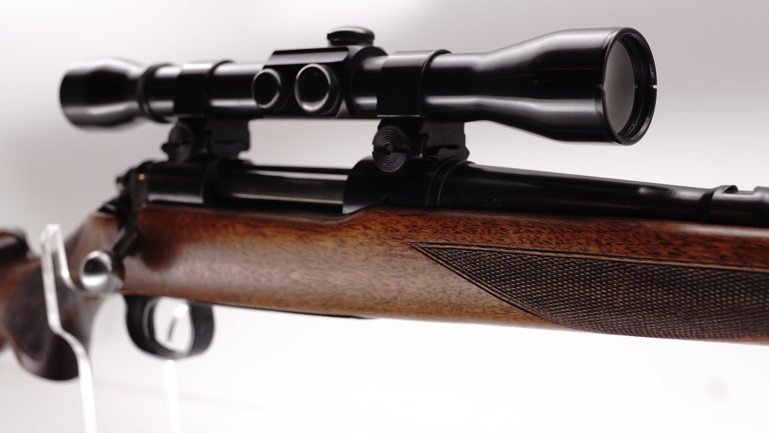 In 1949 the world was getting back to normal, having babies and living life after the most atrocious event the world would see up to and including today. In 1948 Remington introduced the 721. In September of 1949 the above 721B was made as one of the very first and few 721B's ever and probably sat on the shelf at a hardware store waiting for its owner. Likely a couple of months later it had one and also Weaver's first ever variable scope, the KV which was new in 1950. As for mounts, well, since the Weaver detachable top mount was also introduced in 1949, we just had to round up a brand new pair as well as an original set of Weaver bases to complete this fantastic build.