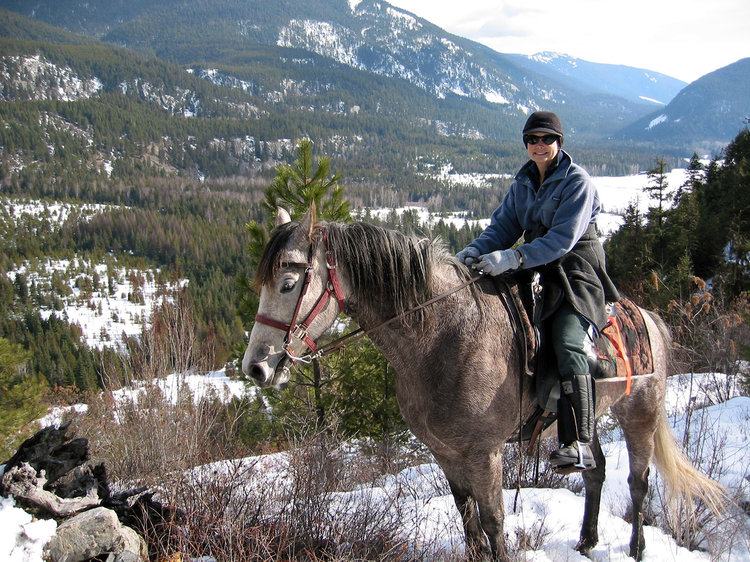 <p>Delia rides her beloved mare, Stormy Girl, in the mountains overlooking her home in Idaho. Mark J. Owens.</p>