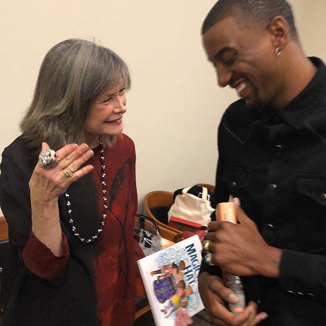 Hanging out with author and football hero Malcolm Mitchell at University of Georgia. I'm wearing his Super Bowl Ring and holding his fabulous book 'The Magicians Hat'. He is a champion for reading!!!