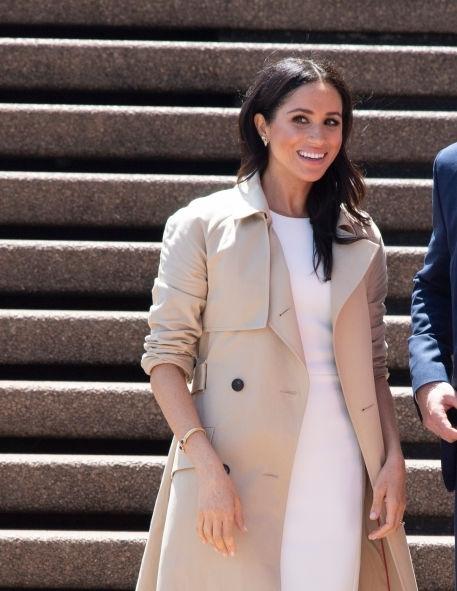 Day 1 in Sydney she wore an Australian designer, Karen Gee dress for AU$1800 and coat US$1690