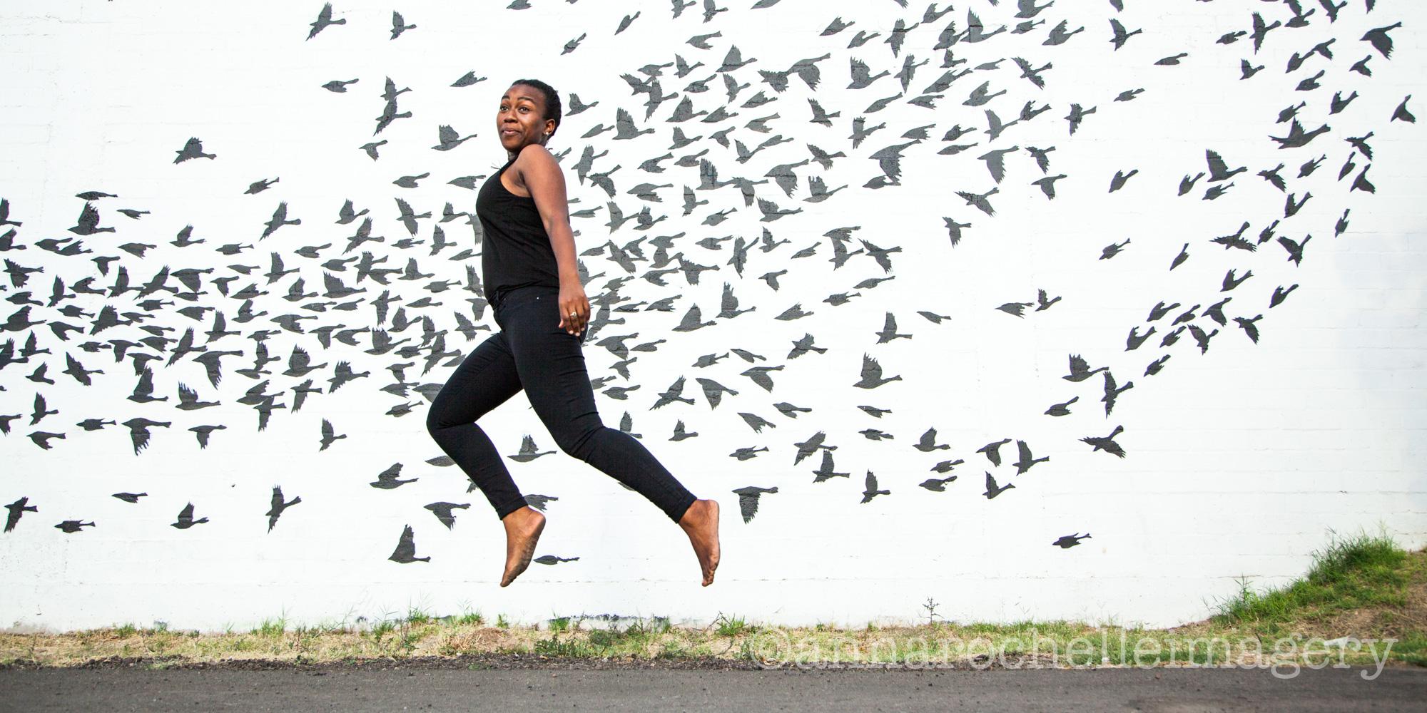 girl-jumping-phoenix-roosevelt-mural-anna-rochelle-creative portrait photographer.jpg