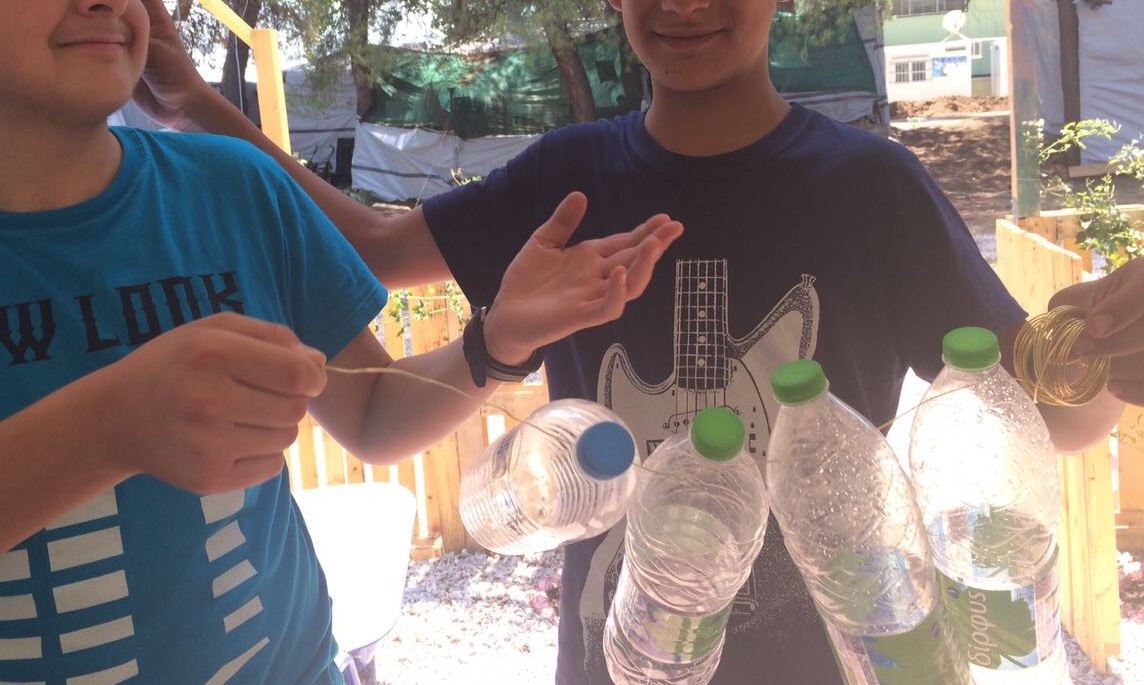 Members of the YES show off their water bottle sculpture