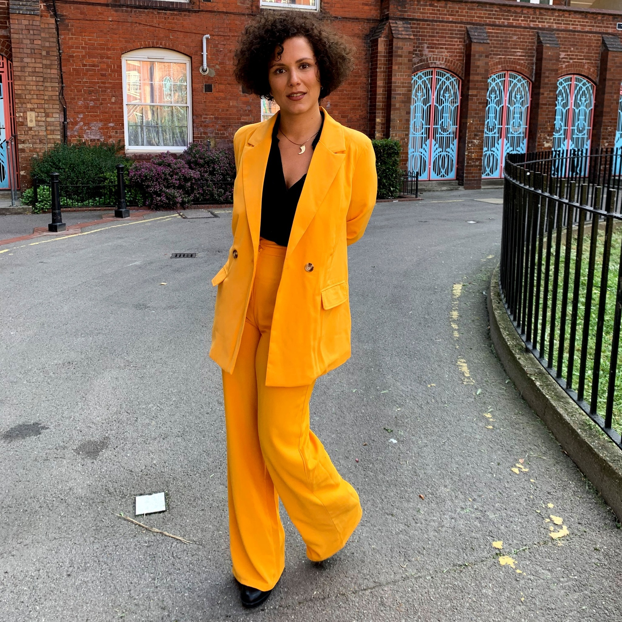 Right before the convocation ceremony at the Royal College of Art; I don't often dress up, but when I do, I make sure it's a bright yellow suit.