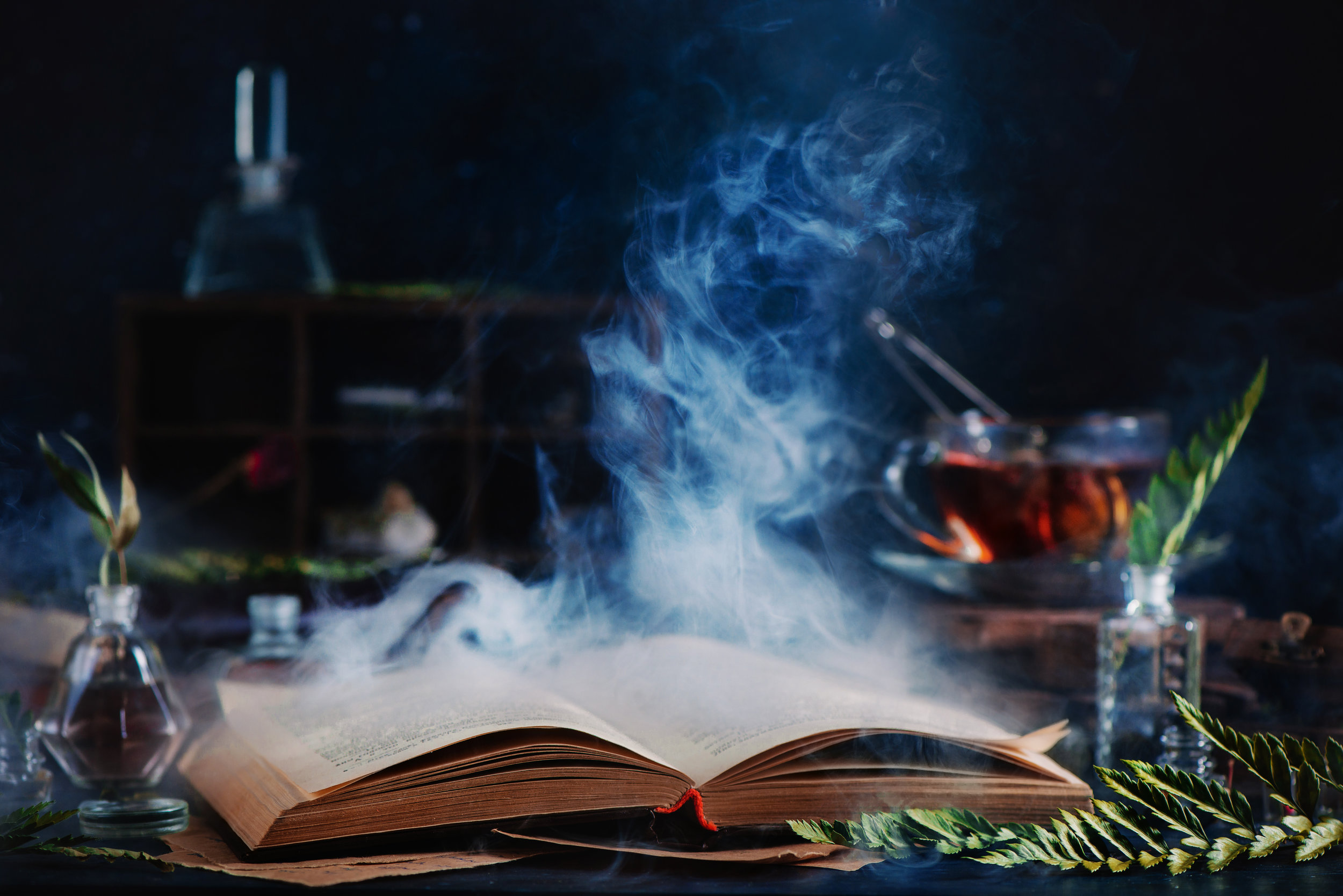 open-spell-book-with-magical-smoke-P7PHXTF.jpg