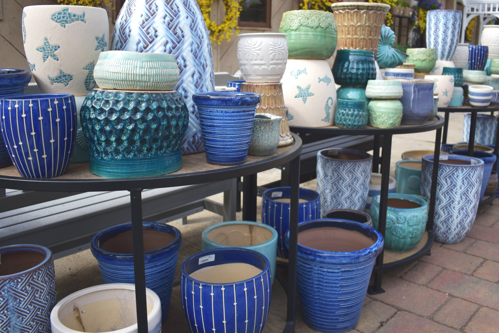 Use fun pottery to add color and texture to your indoor and outdoor plantings.
