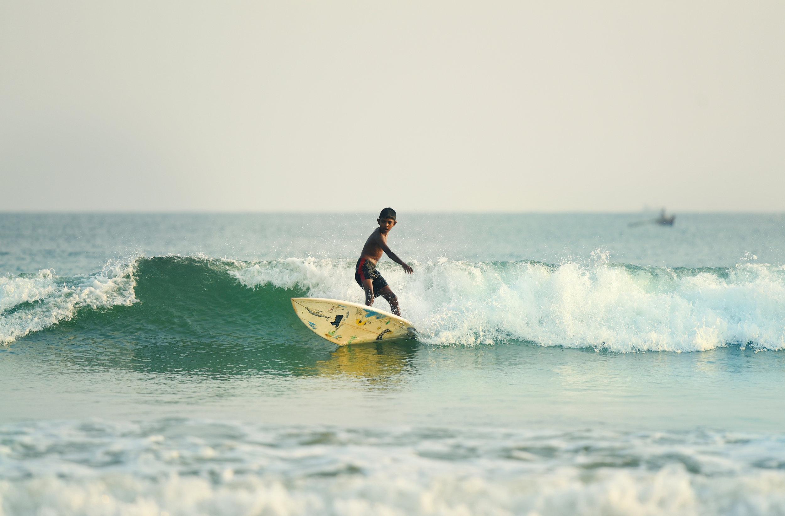 Grom local boy surfing in Sri Lanka