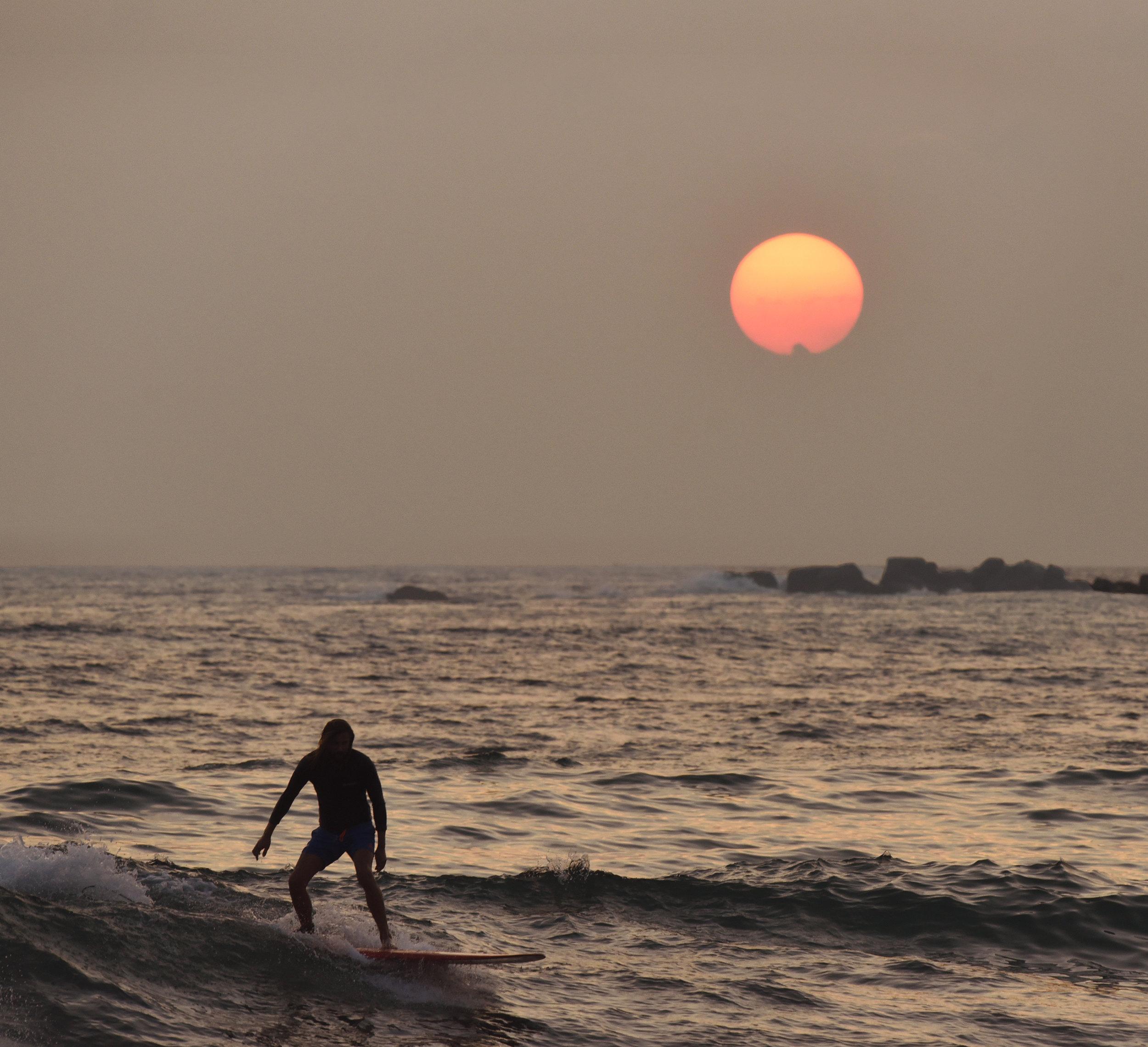 Surfing into the sunset Sri Lanka