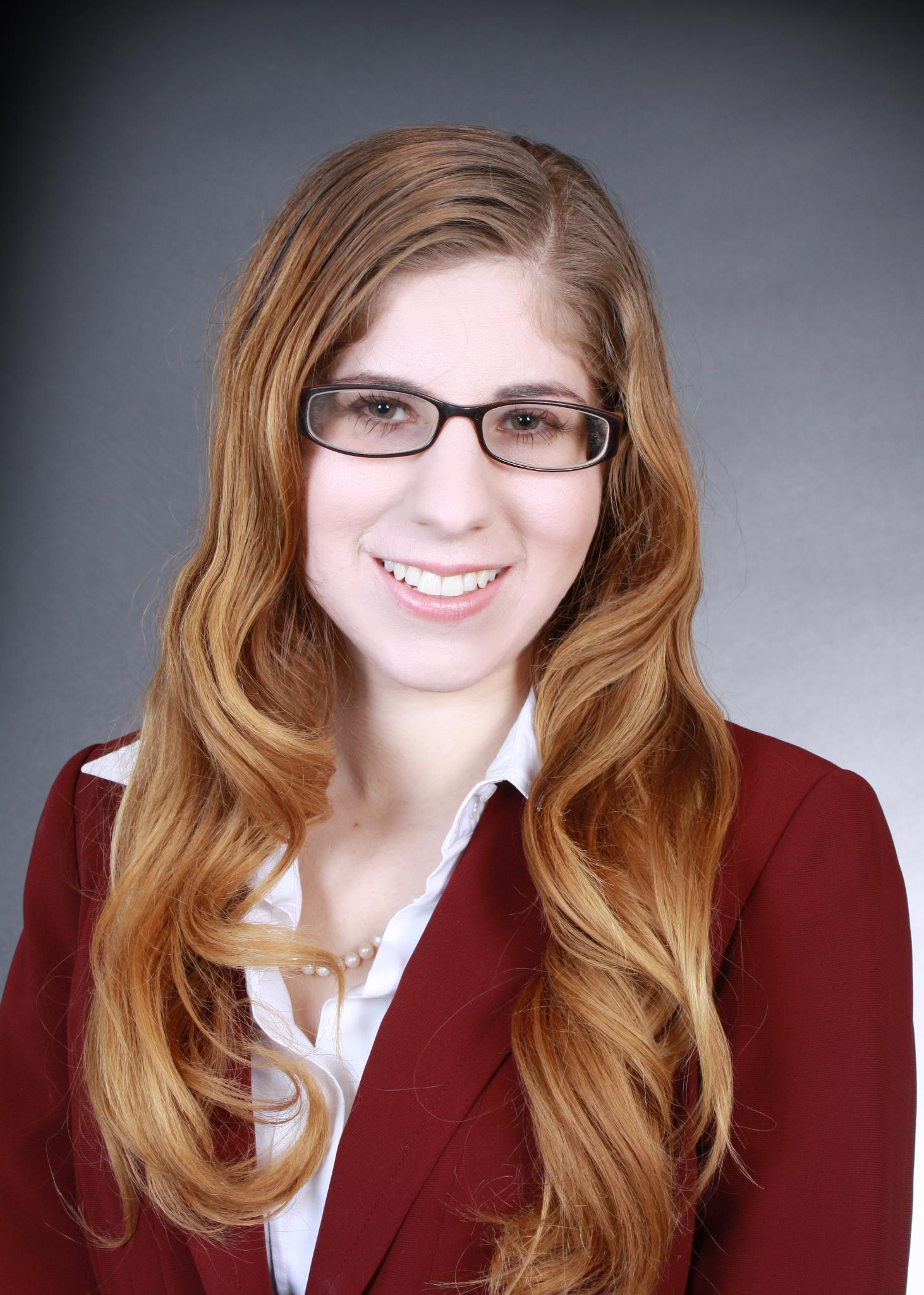 Hannah Hammersmith in Burgundy Suit for Attorney at Law