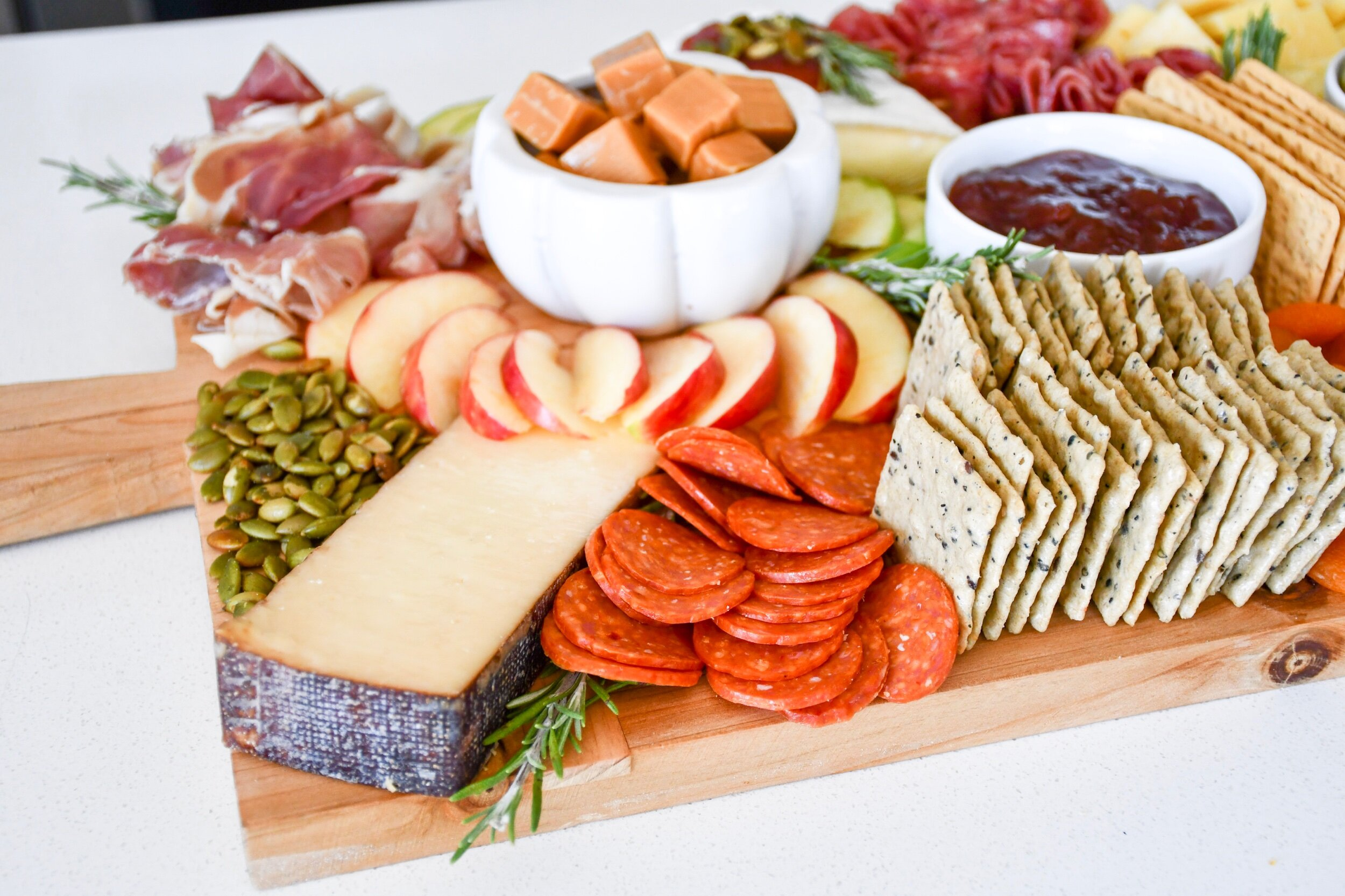 Fall Inspired Charcuterie Board | tarynintotravel.com |  #cheeseboard #partyfood #foodcenterpiece #charcuterieboard