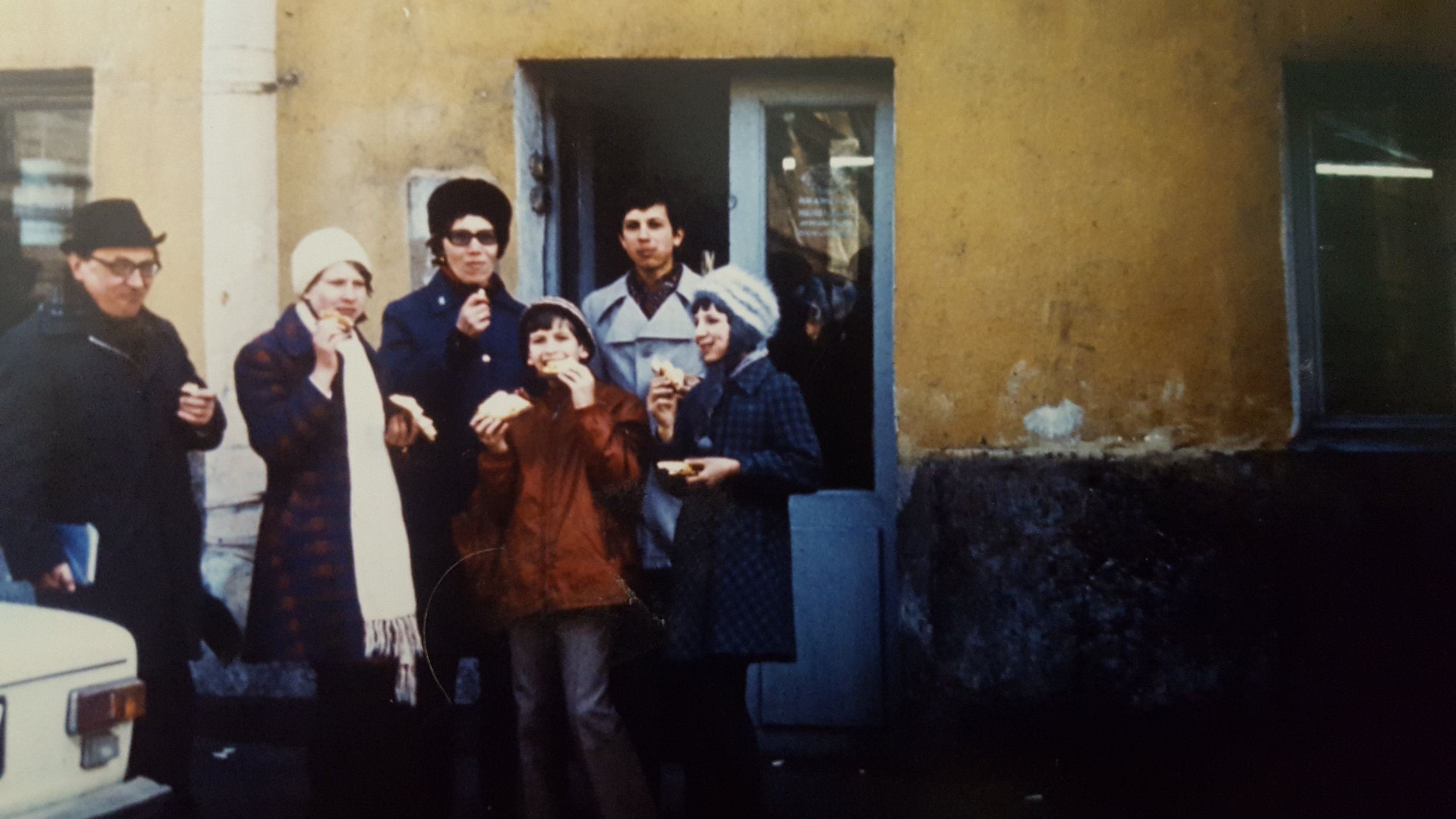 My mom (far right) with her brother Oleg (behind her) and her aunt Elya with her children Anna and Dmitry before they immigrated to the USA. Note the random photo bomber!!