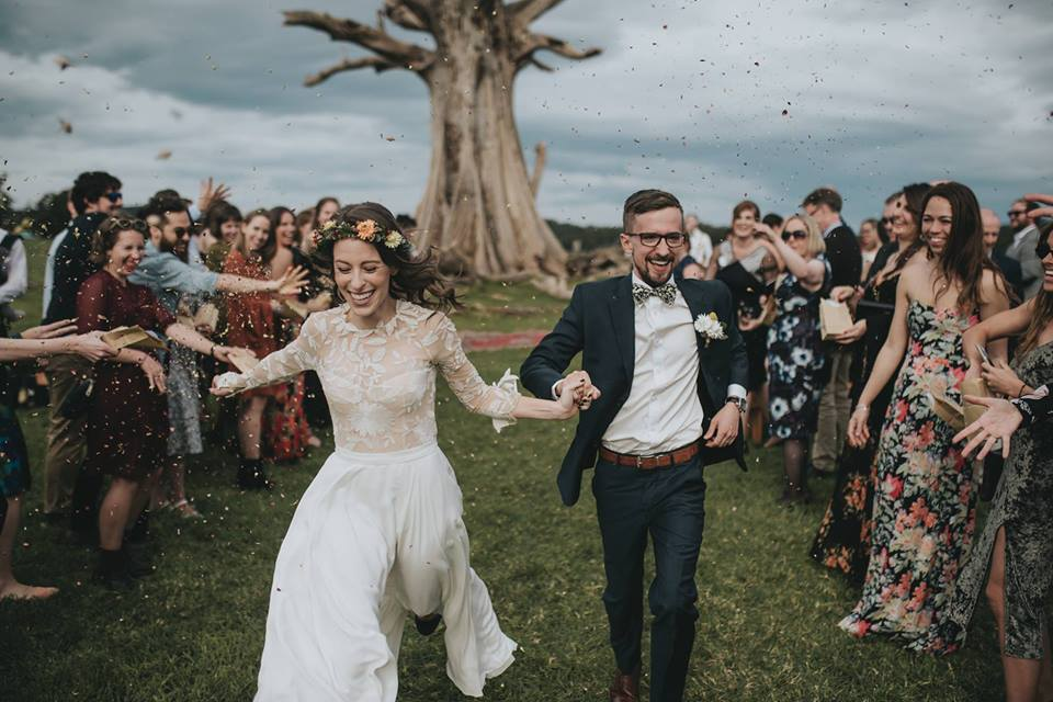 BRIDIE AND LUKE SPRINTING DOWN THE AISLE DODGING CONFETTI!