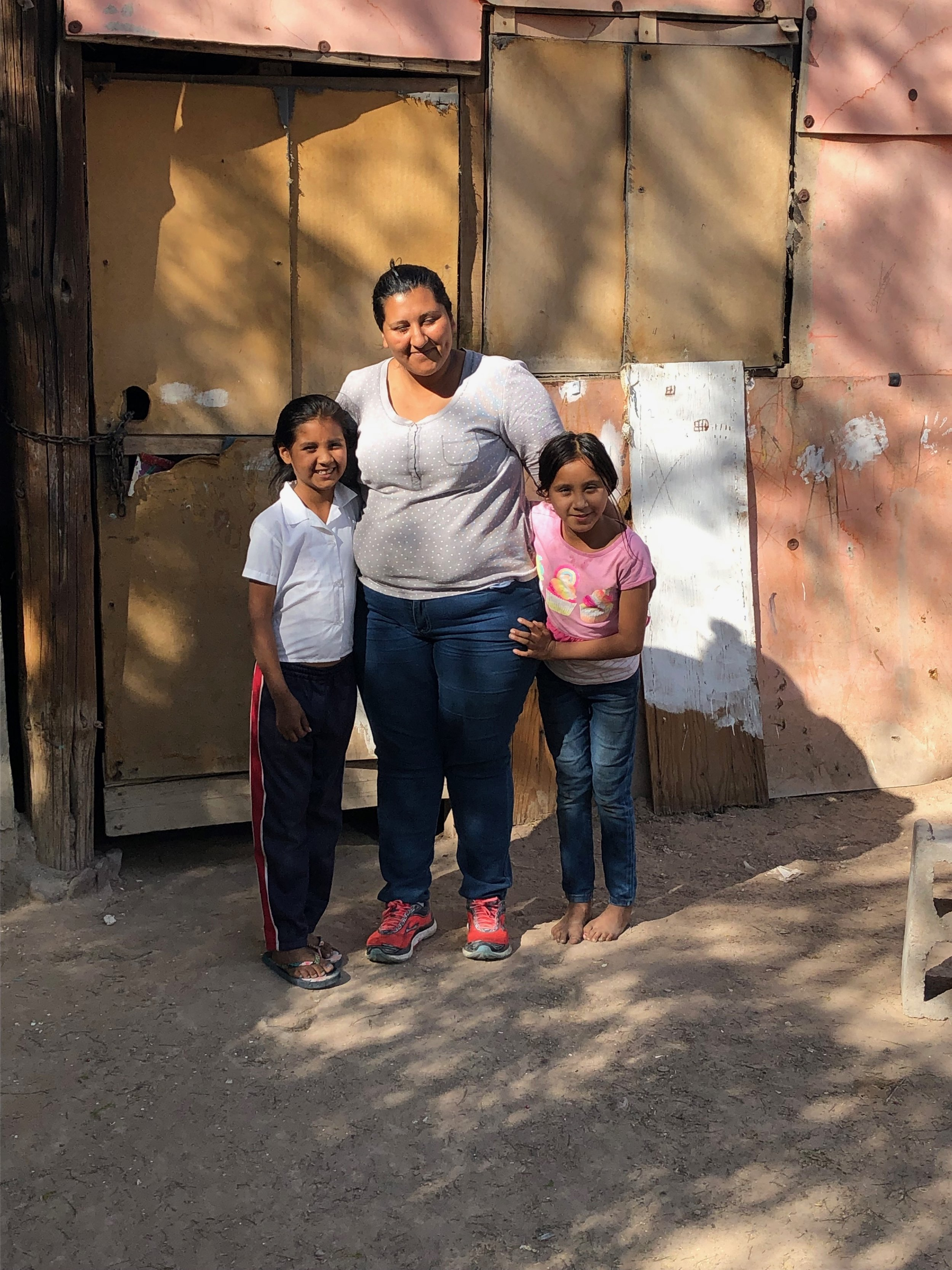 Maria and two of her girls. Maria is a single mom and our cook. We sponsor all four of her girls into the school.