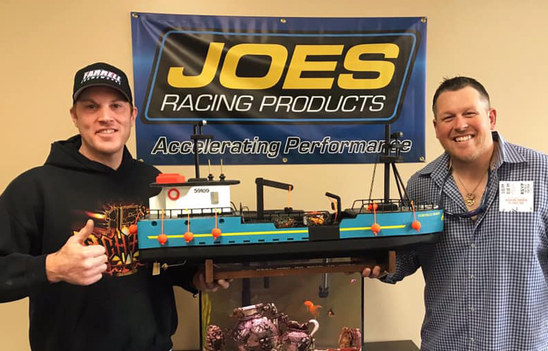 Pictured at Joe's Racing Products is Jon Farrell and Deadliest Catch's Capt. Casey McManus. Kenny's Dad, Rich, built this model boat of the Cornelia Marie for Jon.