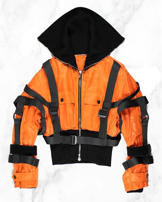 Releasing exclusively at Grailed LA: Dolce & Gabbana AW2003 Safety Orange Bondage Jacket. This bondage aviator, which was released in several iterations, features the bold safety orange which was in vogue during this era, and ascribes an abrasive club kid quality to the typically severe militant interpretations of bondage wear which defined this era of Dolce & Gabbana. Find this at Grailed LA until the 12th at 7907 Rosewood Ave, Los Angeles, CA. #middlemanstore #grailedla