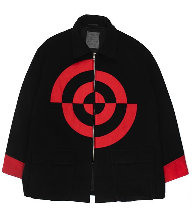 "For all those who couldn't make it to last week's popup, we're offering 20% off EVERYTHING on our site - use code ""POPUP20"" at checkout. From the Middleman Personal Collection: Yohji Yamamoto Pour Homme AW1990 Bullseye Jacket. This jacket ironically ascribes a chaotic quality to a bullseye — something by definition deathly still — by reconstructing it in an asymmetric pattern, and adding the evocative ""Don't Shoot Me"" statement in a similarly hectic font. The jacket has the classic, unstructured silhouette that Yohji often utilized in the early '90s. Not for sale. #middlemanstore"