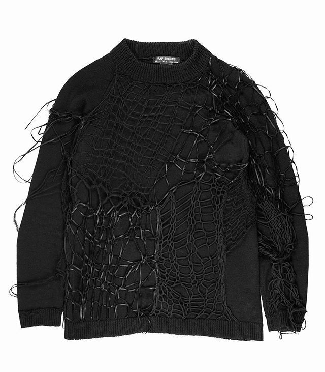 "For all those who couldn't make it to last week's popup, we're offering 20% off EVERYTHING on our site - use code ""POPUP20"" at checkout. From the Middleman Personal Collection: Raf Simons AW1998 ""Radioactivity"" Spiderweb Sweater. This punk-influenced sweater stands as one of the most impressively constructed pieces from the early aughts of Raf's work, in which aesthetic choices and budgetary constraints often limited the material complexity of Raf's clothing. This wool knit is layered with a unique leather, mohair, and cotton spider web which gives the top a 3-D quality. Not for sale. #middlemanstore"