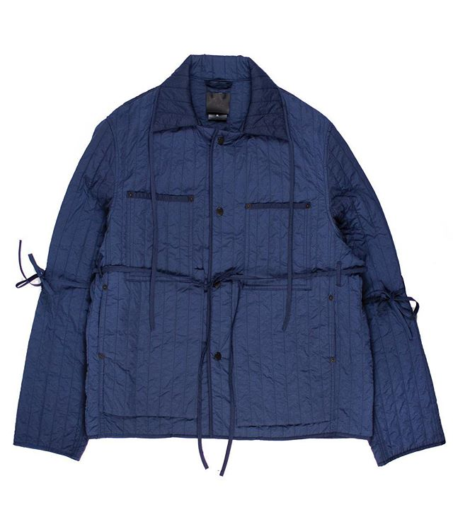 From the Middleman Personal Collection: Craig Green SS2016 Quilted Workwear Jacket. While the workwear jacket has appeared in numerous forms throughout Craig Green's body of work, the SS2016 iteration stands as the strongest. Done in a lightweight quilted nylon—featured on a number of pieces in the collection—it notably bares ties around the arms and body. This detailing is exclusive to SS2016, and offers a unique flair to the otherwise classic silhouette. Not for sale.  #middlemanstore