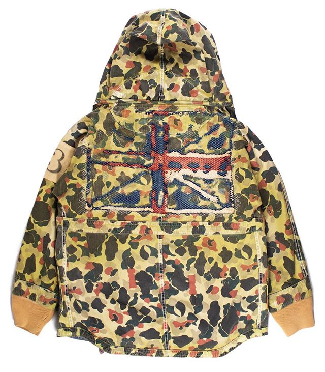 "Releasing Friday: Kapital Kountry Boro Union Jack Ring Coat. The term boro is used to define a sort of patchwork fabric that emerges from the natural degeneration and repair of lesser fabrics. The word itself comes from the Japanese term ""boroboro,"" for something tattered or repaired. In their era, boro fabrics were often used to distinguish someone of the lower class. Since access to cotton and silk was reserved for the higher realms of society, peasants often had to reweave linens together to reinforce clothing. In the centuries since, working with boro fabrics has became an art intrinsic to many of the most respected brands in Japan. Kapital's work with it is among the finest, as displayed inventively on this jacket, where the boro fabric is used to construct the Union Jack. It further harkens back to British military garb with a ""1335"" sleeve insignia, yet remains quintessentially Kapital due to their famous Ring Coat silhouette. Available Friday the 26th, 12:00PM EST (-5 GMT), at Middlemanstore.com. #middlemanstore"