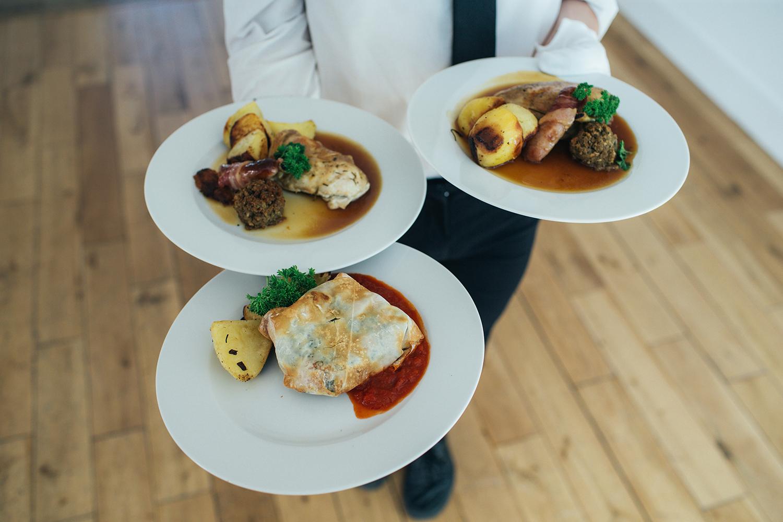 Wedding meal in servers hands