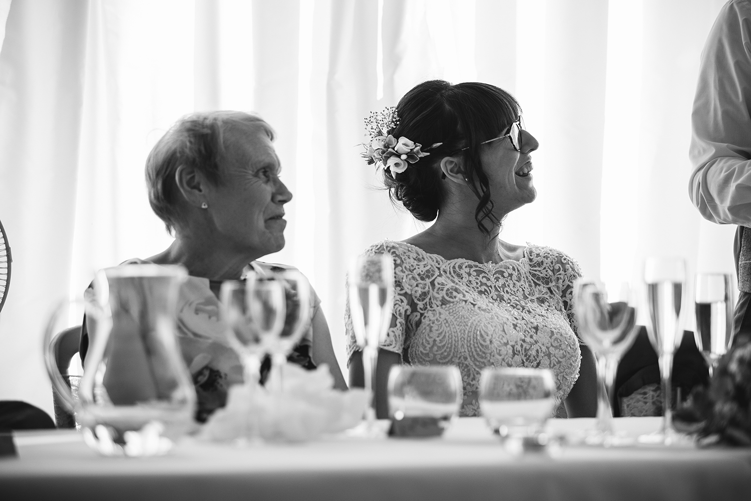 Bride and her mother listening to Groom's speech