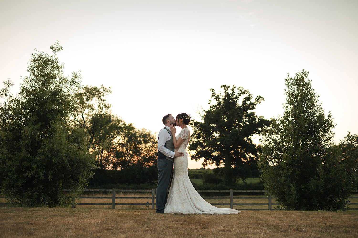 Bride and Groom kissing on the lawn