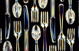 Plastic utensils made from biodegradable starch-polyester material.  Scott Bauer/USDA