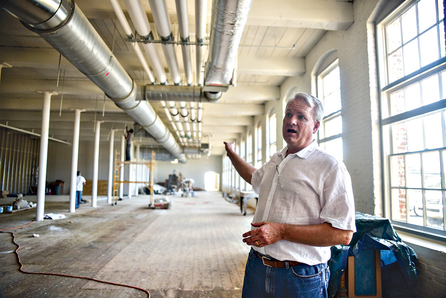 Castleberry stands inside The Mill during construction / Photo by Luisa Porter