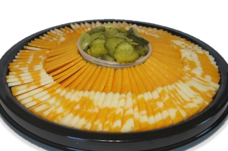 Cheese Platters - We will assemble cheese platters for your event. Let us know what kinds of cheeses and we will do the work for you. The photo has a marble cheese, onion and parsley cheese, & medium cheddar cheese along with Zehr's Country Market Pickles.