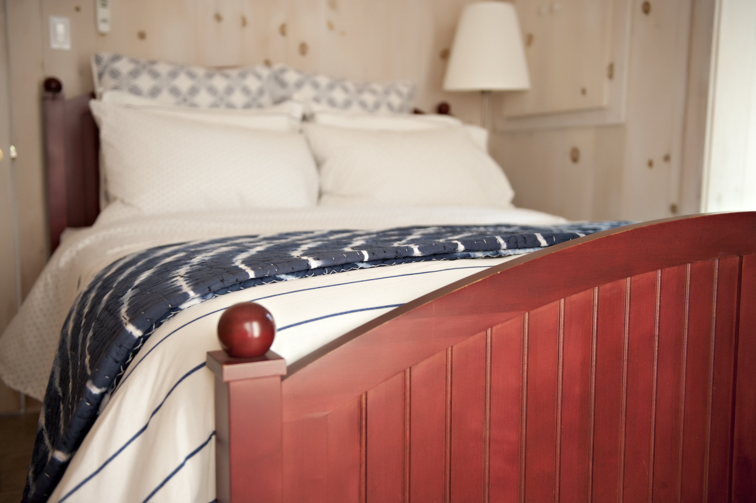 Candace-Plotz-Design-Beach-House-2-Navy-Bedding-Red-Wood-Bed