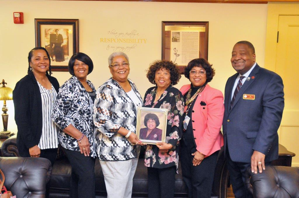 Pictured from left to right are Ms. Denise I. Henson ('79), Mrs. Dorothy Kasey McNeill, Mrs. Darlene E. Holmes ('78), holding the picture of the late Mrs. Mary F. Henson ('83) with Mrs. Mary Diana Sutton ('76), Rev. Dr. Deborah (Dee) Henson-Governor ('73), and Interim President Hubert L. Grimes