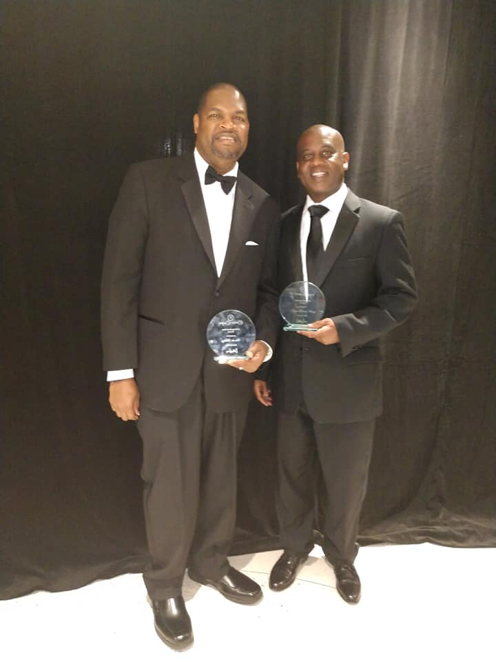 Charles Mallory photographed with Daytona Beach Mayor Derrick Henry who also received an award at the Emerald Ball