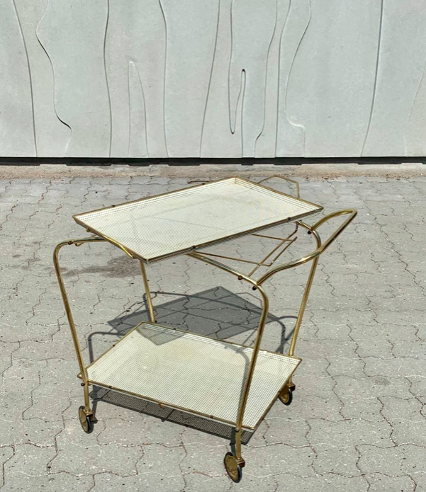 - be still my beating, vintage bar cart heart. I fell in love with this bar cart. It would be such a great addition to our new front room. I love the dull gold and the perforated off-white shelves. Think of the amount of gin we could store on this! this comes in at £1156 which is a higher price point but quality design costs money doesn't it! plus it'll be a one-off.