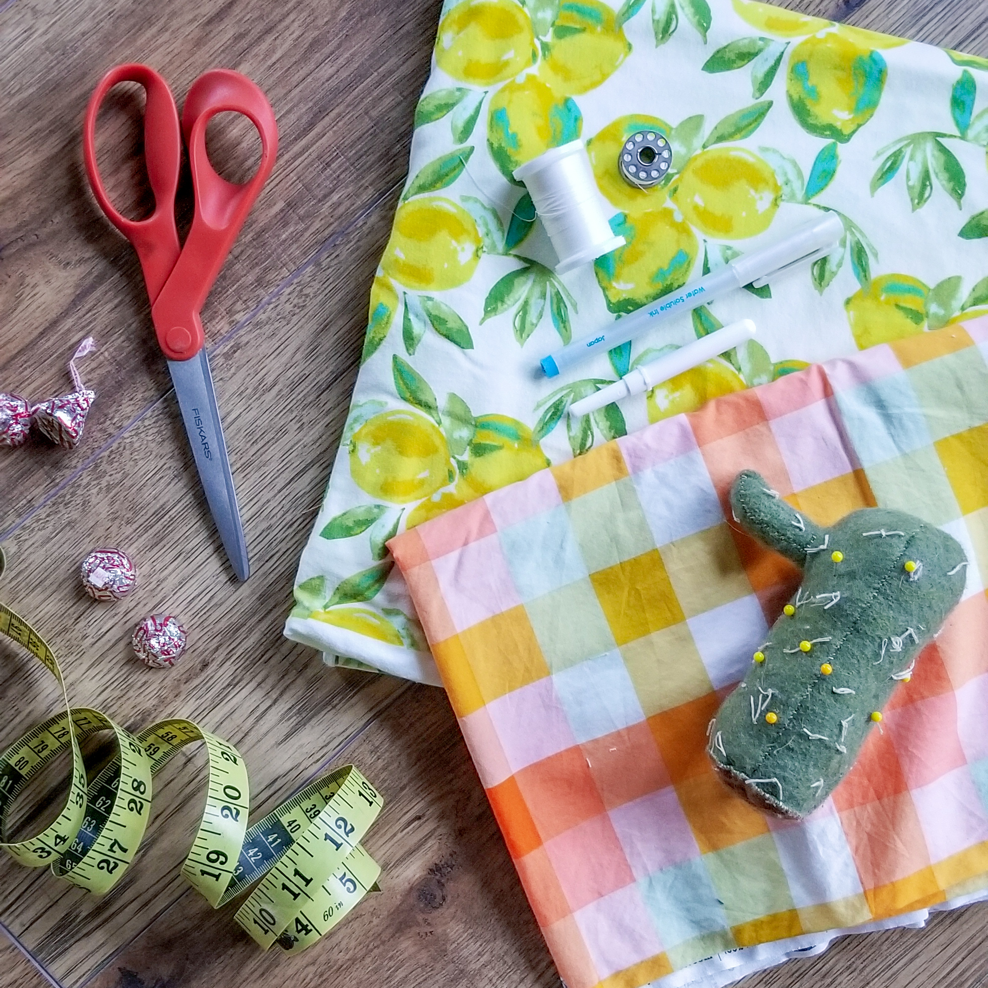 I somehow have lost my ruler so I used a measuring tape, but ideally a flat ruler is preferable for this project. Also, some sort of a snack is a must. Ya know, in case you get famished along the way or need a little encouragement. And I didn't end up using this combo together but it's so stinking cute right? Lemon fabric is  Art Gallery Sage Jersey Knit Yuma Lemons Mist Fabric  and the plaid is  Art Gallery Day Trip Summer Picnic Plaid Fabric .