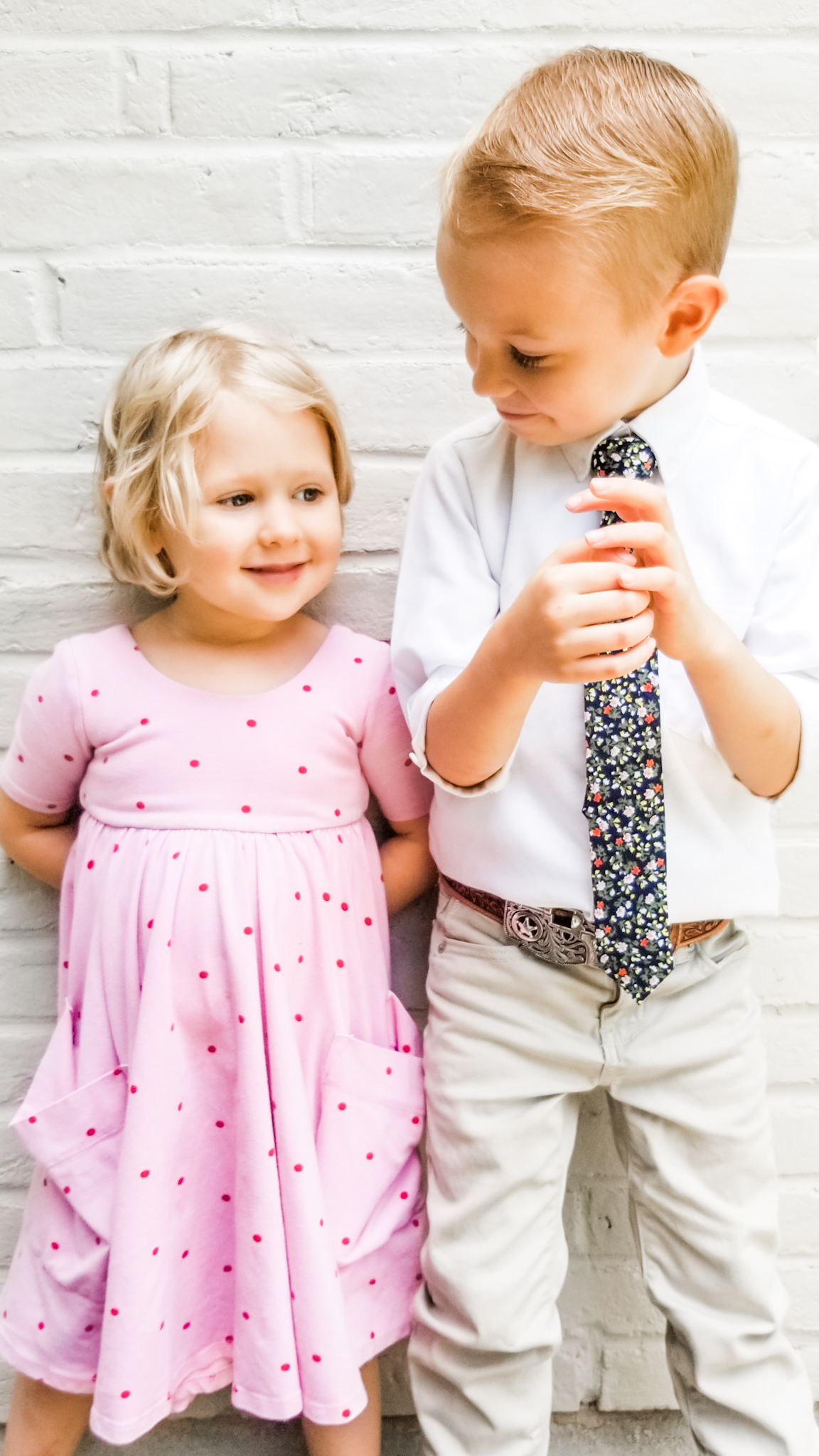 I just can't get enough of this picture. Like Wesley looks like a little MAN and Pepper is just as sweet as sweet can be. Outfits : Wesley- Old Navy Pants (new), white button-up (used), ZUZU tie (new). Pepper-  Remie girl  dress (ethical)