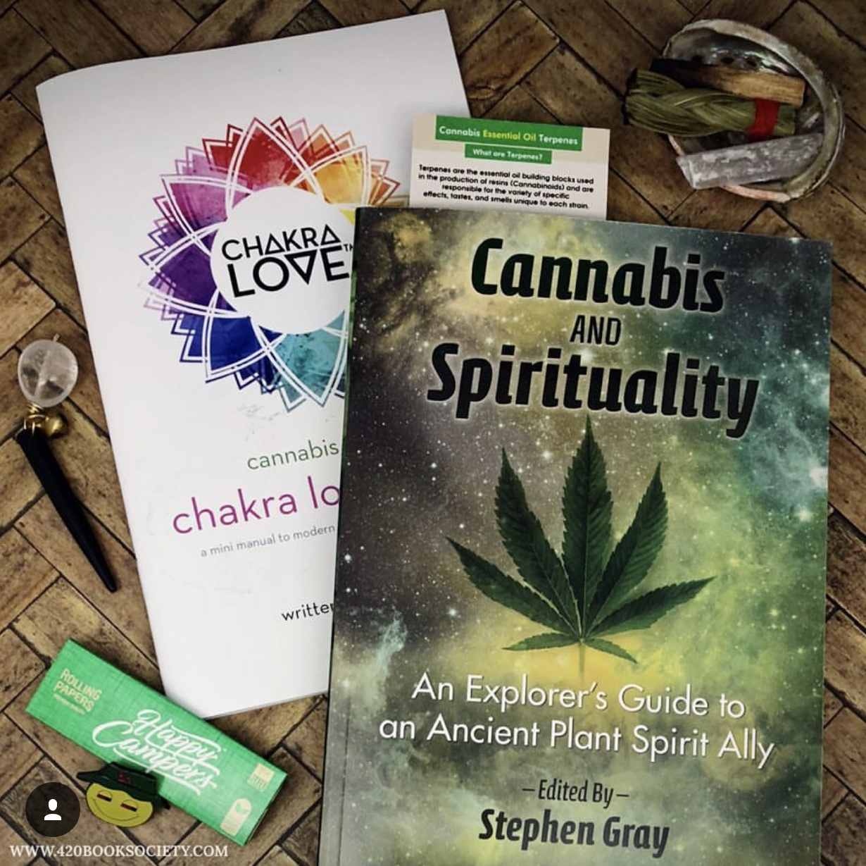 "August 2018    This months membership features ""Cannabis and Spirituality"", An Explorers Guide to an Ancient Plant Spirit Ally by Stephen Gray  Cannabis and Spirituality reveals the potential of ""the people's plant"" to enhance many different spiritual practices, included yoga, meditation, visualization, and much more. This guide shows how cannabis is an effective tool on the awakening journey, helping us feel closer to nature, each other and ourselves. Also included with August book of the month is ""Chakra Love Basics, Cannabis Edition"" mini manual and quartz cone stuffer by Chakra Love Cannabis and a Smudge Kit to Go including sweetgrass, palo santo, and selenite and as always a few other surprises."