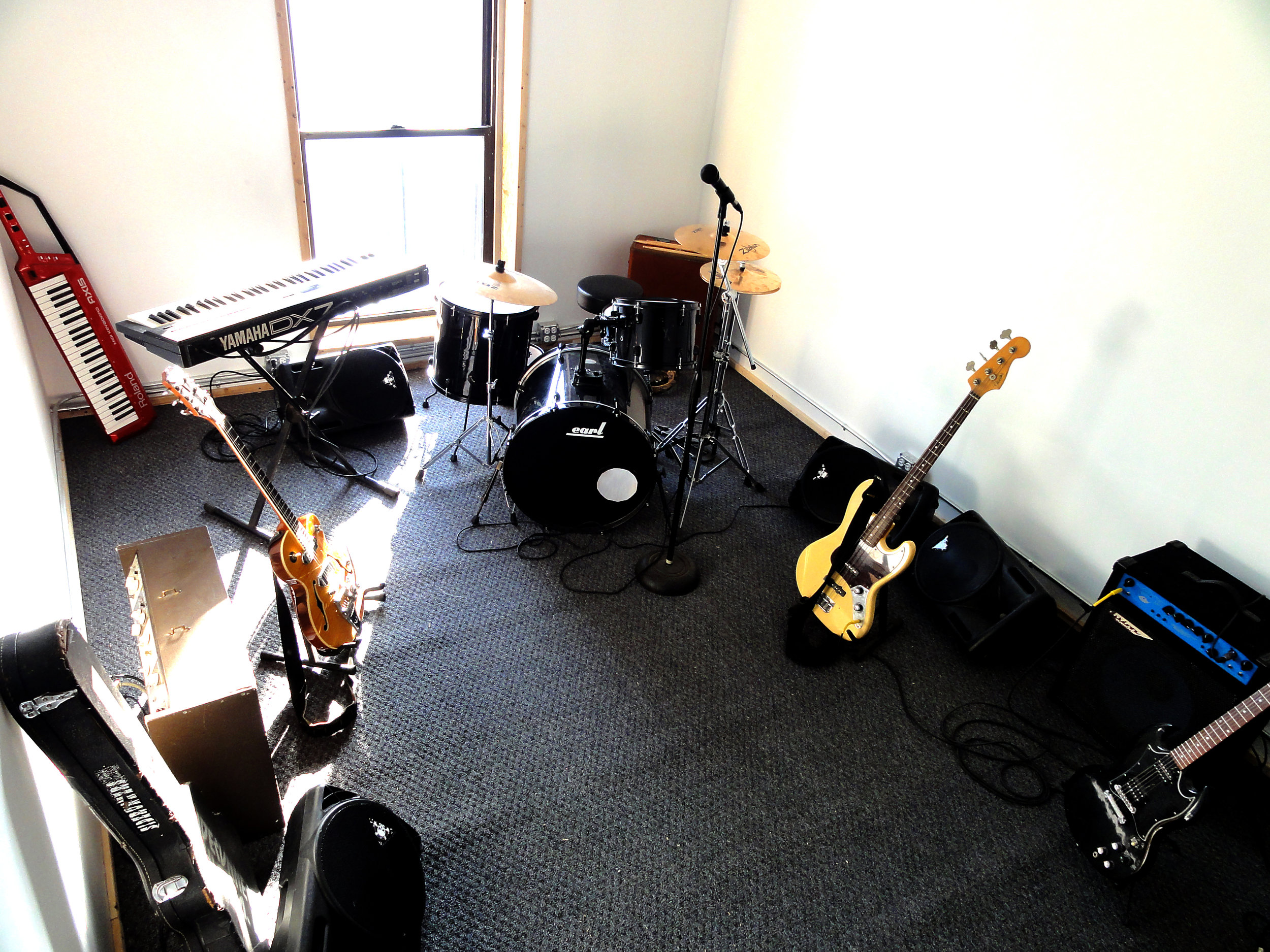 Studio-c7: The Office - We provide a guitar amp, a bass amp, a drum kit. If you'd like to use any special gear, including our Hammond C3 organ, there is an additional $5 charge per piece of gear.